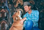 Viggo with dog in tack room