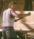 Clay (Viggo Mortensen) working as a carpenter, building coffins.