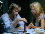Clay nurses his beer as Callie prepares to ask a question. (Viggo Mortensen, Ashley Judd)