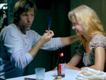 Clay loves magic tricks. Here he pulls a feather from behind Callie's ear. (Viggo Mortensen, Ashley Judd)